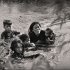 09/1965, Loc Thuong, Binh Dinh, Vietnam. Kyoichi Sawada, Japan, United Press International. A mother and her children wade across a river to escape US bombing. The US Air Force had evacuated their village because it was suspected of being used as a base camp by the Vietcong.