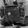 24/2/1966, Tan Binh, Vietnam. Kyoichi Sawada, Japan, United Press International. The body of a Vietcong soldier is dragged behind an American armored vehicle en route to a burial site after fierce fighting.