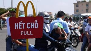 People at the McDonald's opening in Ho Chi Minh city on February 8, 2014. Ảnh: AFP