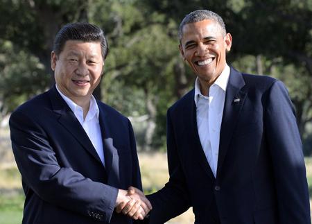 Ảnh năm 2013: Tổng thống Mỹ Barack Obama và Chủ tịch Trung Quốc Tập Cận Bình bắt tay nhau tại Sunnylands ngày 7/6. Dân Trí